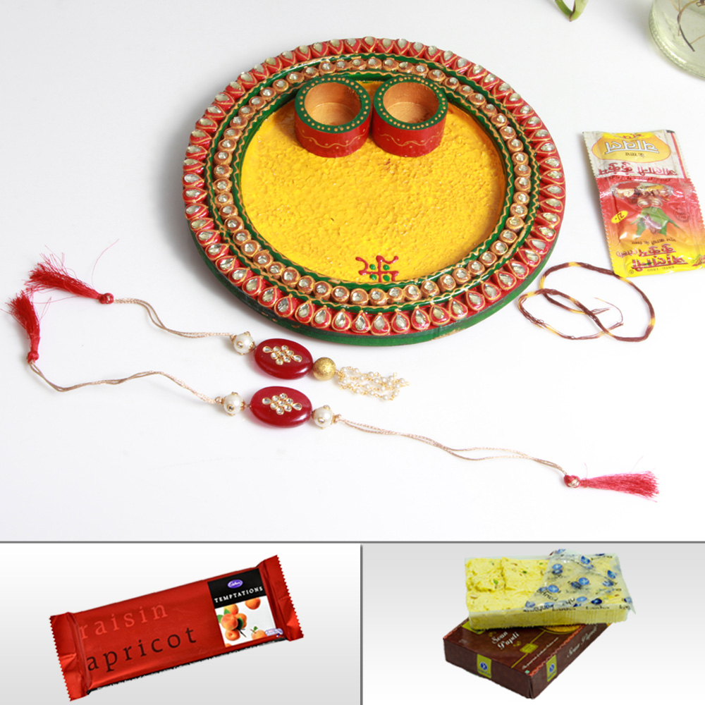 Send rakhi to India with wooden kundan pooja thali, sweets and chocolates