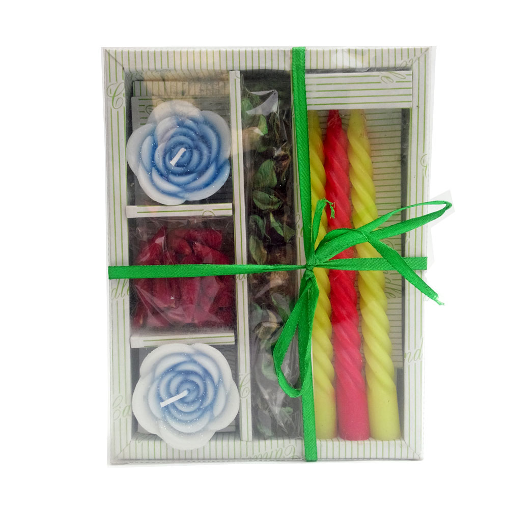 Candle hamper containing 2 floral shaped wax candles, floral petals and colored wax candle sticks