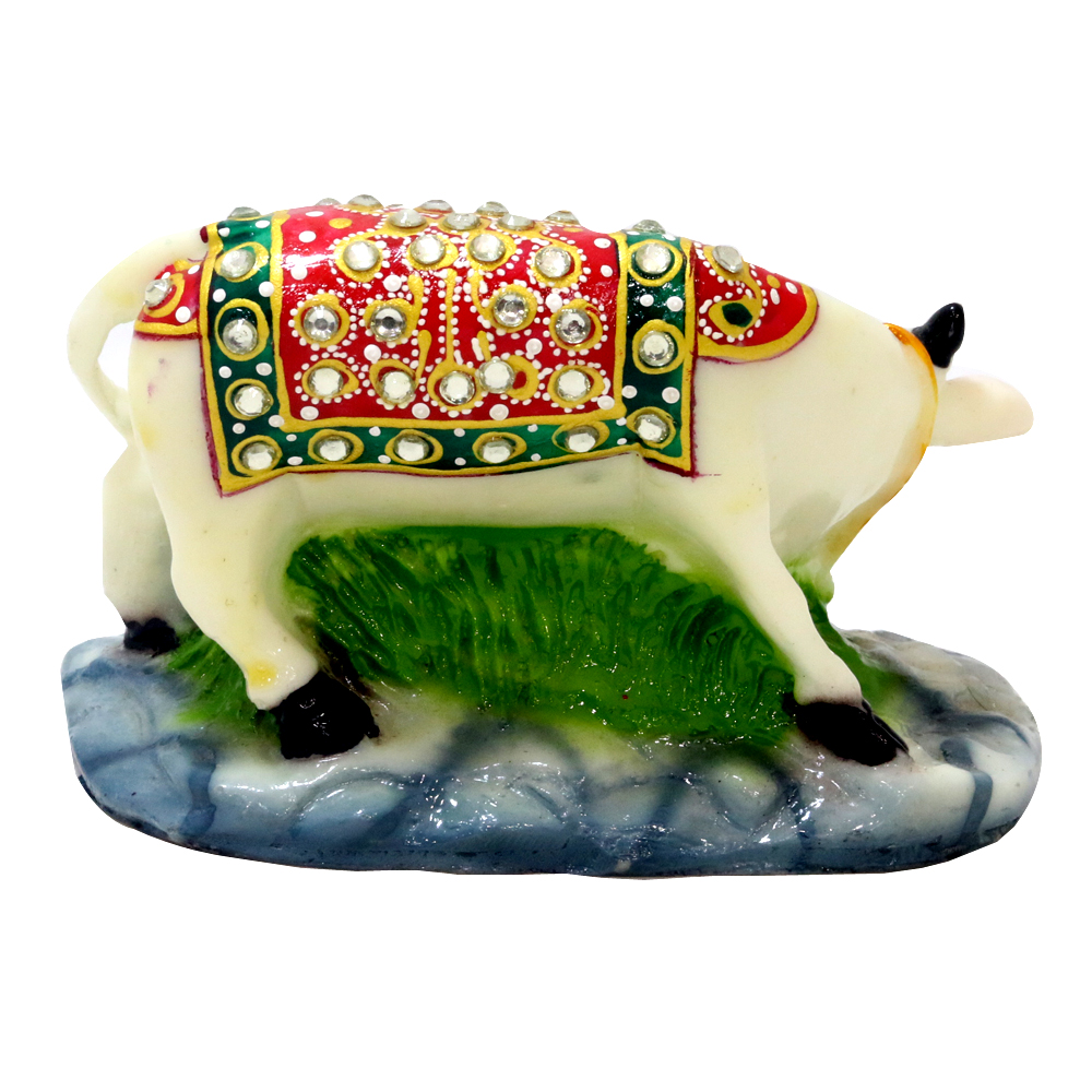 A flamboyant set of resin crafted cow & calf pair.