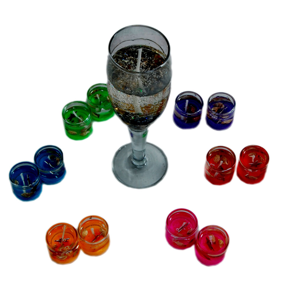 Gel candles in wine glass shape along with 12 gel candles