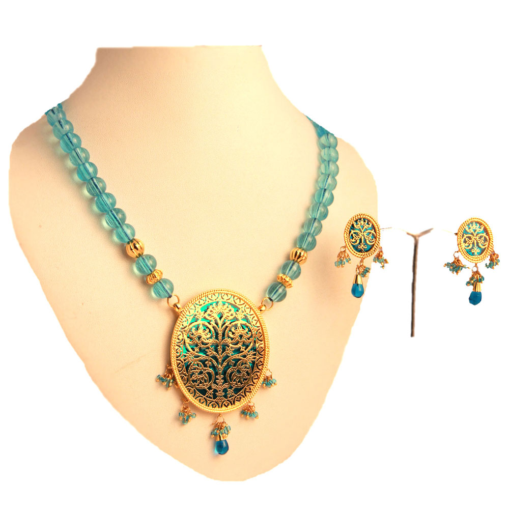 Green pendant set with beaded hangings