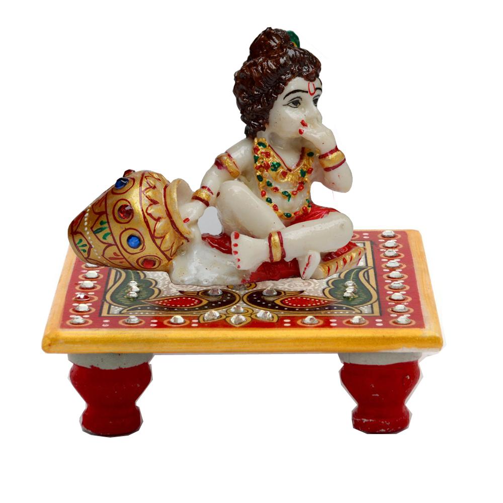 Kanha enjoying makhan statue sitting on chowki