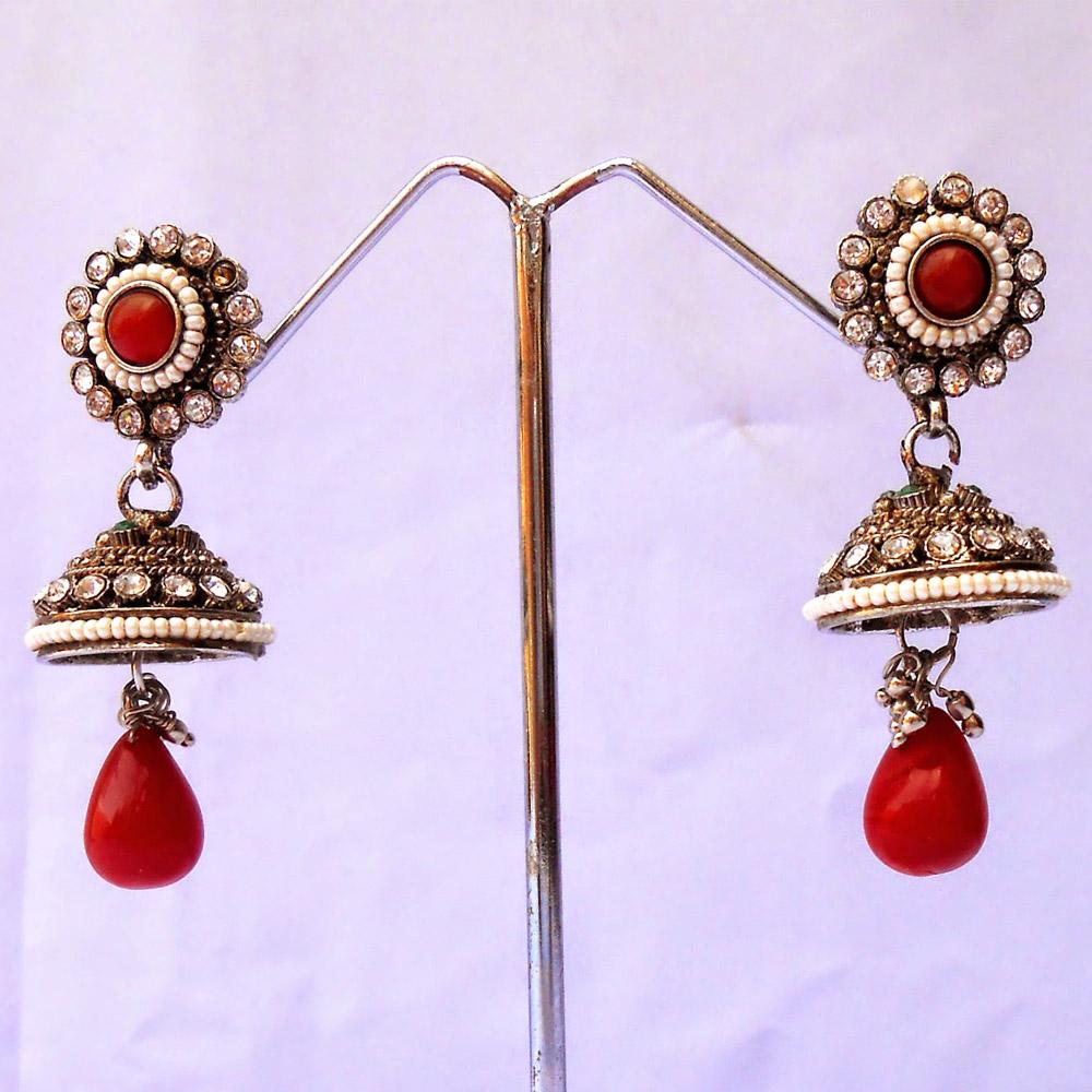 Metal based red jhumka earrings