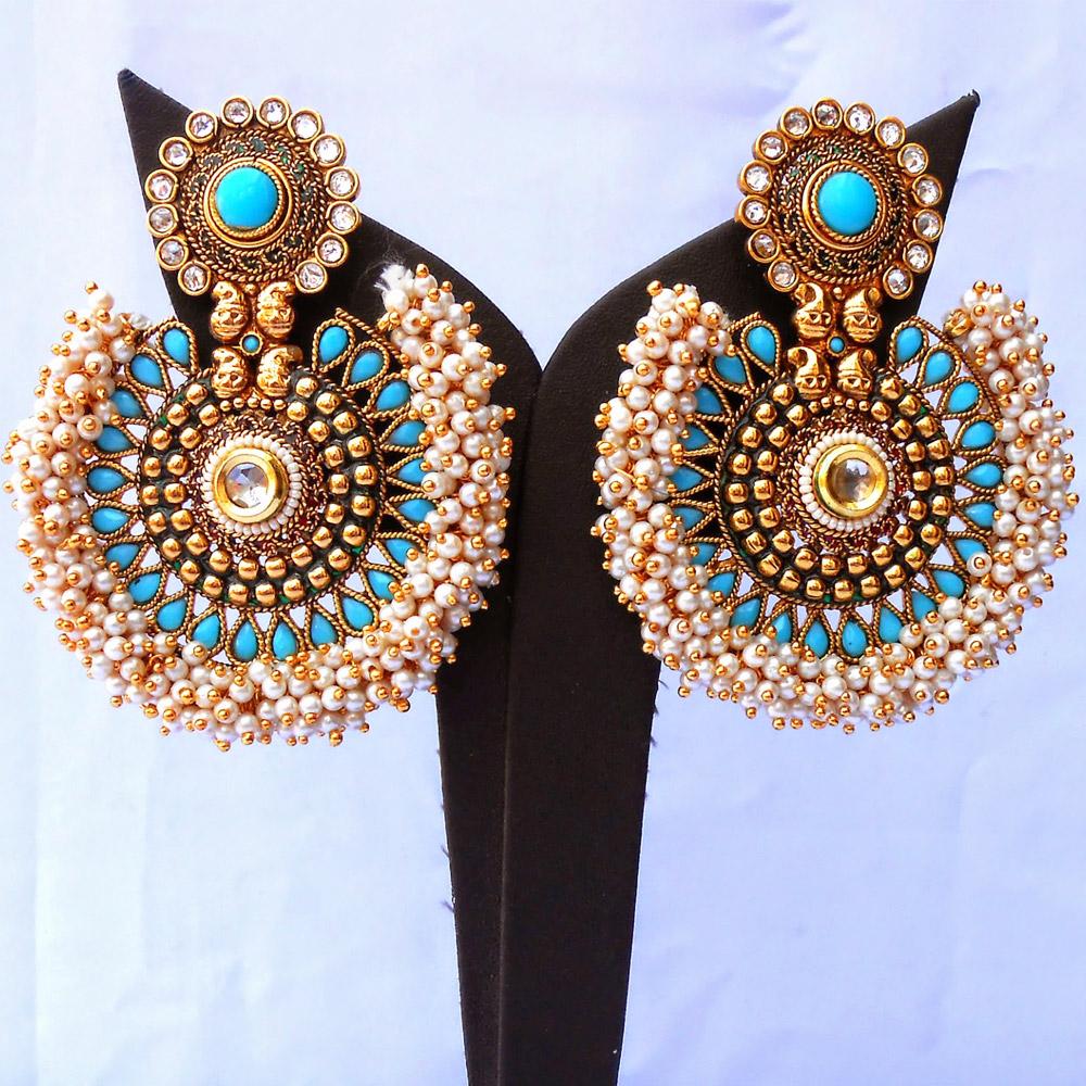 Pearl studded turquoise ram leela earrings