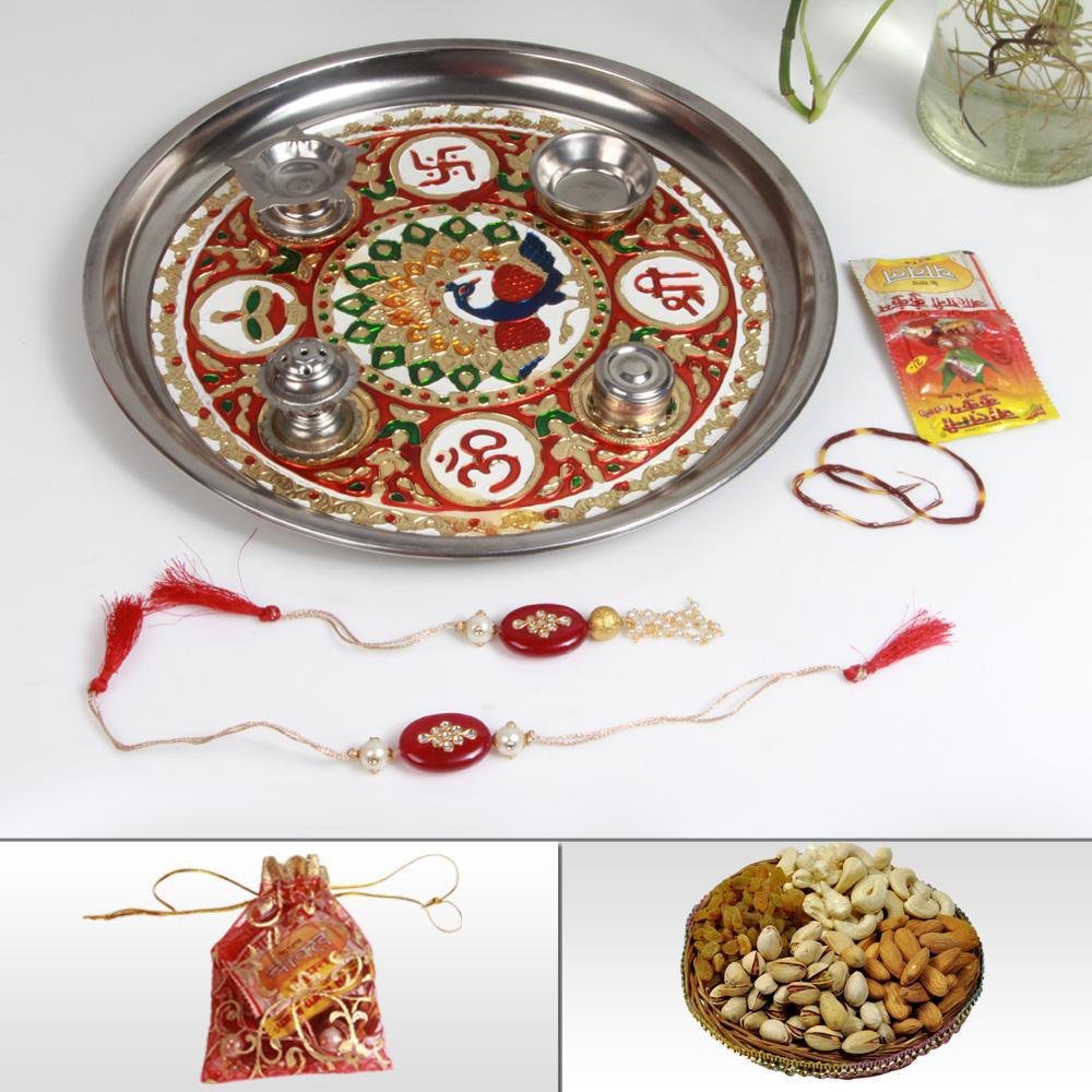 Rakhi pair with steel decorative thali & dry fruits