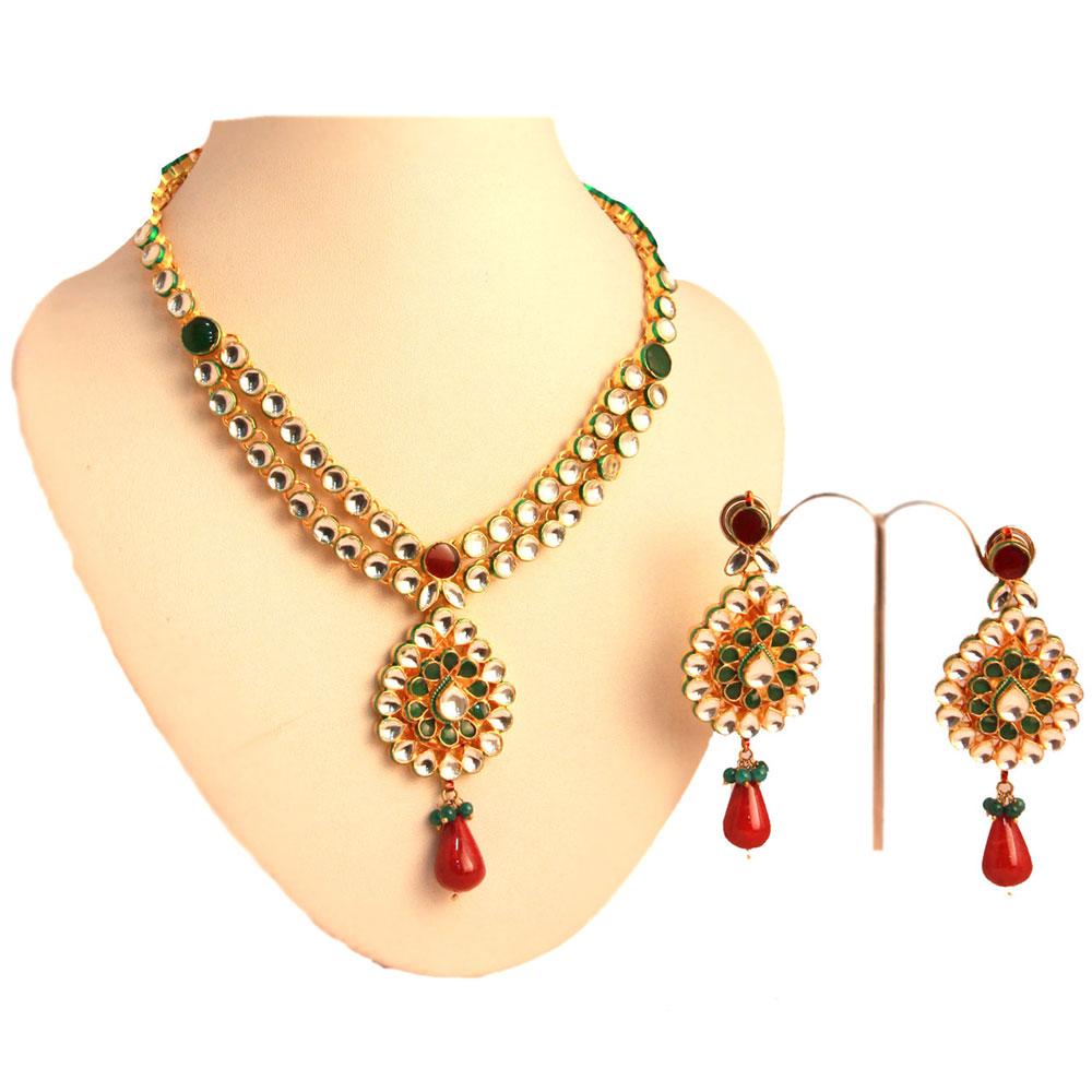 Red stone and kundan set